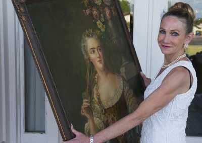 Photo by John Flandrick Elizabeth Stewart holding a painting-06873